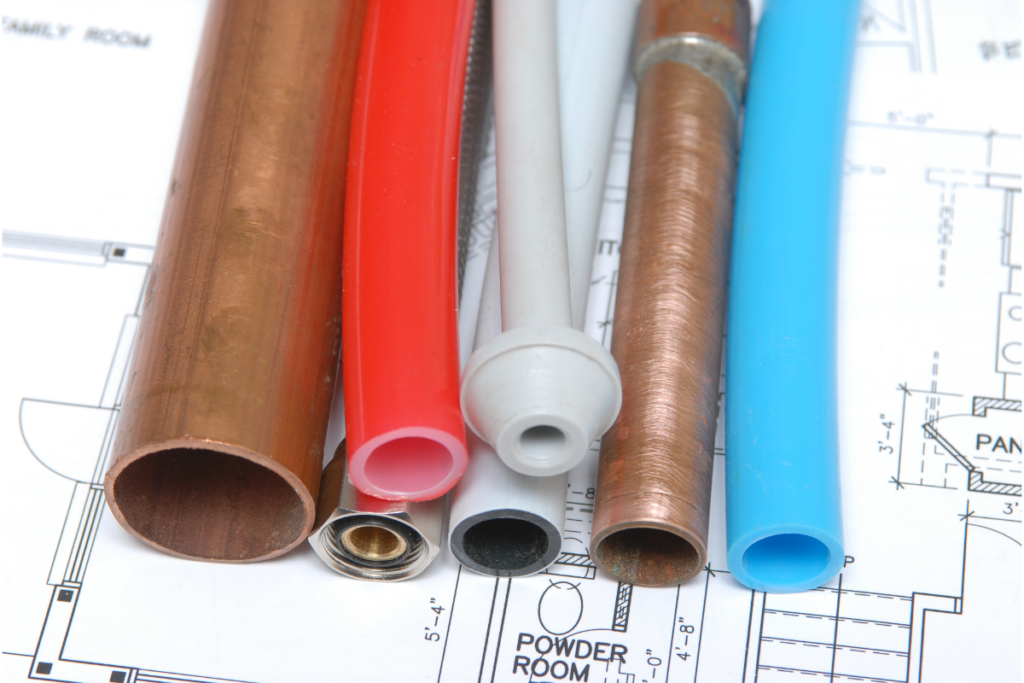 Plumbing pipes of different sizes, colors, and materials.