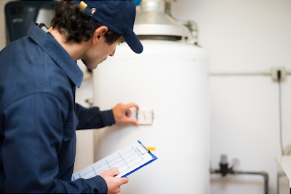 Plumber inspecting a hot water tank