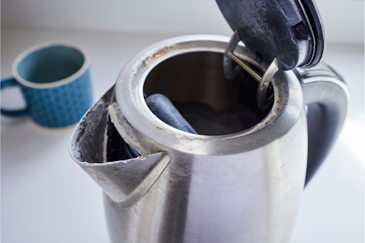 A kettle with limescale buildup.